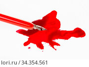 Above view of sharp nib in red dip pen over red ink stain on white... Стоковое фото, фотограф Zoonar.com/Valery Voennyy / easy Fotostock / Фотобанк Лори