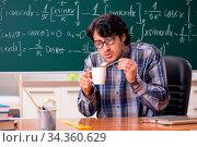 Купить «Funny male math teacher in the classroom», фото № 34360629, снято 4 августа 2020 г. (c) easy Fotostock / Фотобанк Лори