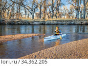 Senior paddler in a decked expedition canoe on the South Platte River... Стоковое фото, фотограф Zoonar.com/Marek Uliasz / easy Fotostock / Фотобанк Лори