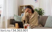 sick woman having video call on tablet pc at home. Стоковое видео, видеограф Syda Productions / Фотобанк Лори