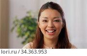 portrait of happy smiling asian young woman. Стоковое видео, видеограф Syda Productions / Фотобанк Лори