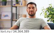 Купить «portrait of happy smiling young man at home», видеоролик № 34364389, снято 24 июля 2020 г. (c) Syda Productions / Фотобанк Лори