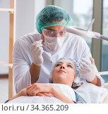 Купить «Woman visiting doctor for plastic surgery», фото № 34365209, снято 16 ноября 2017 г. (c) Elnur / Фотобанк Лори