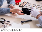 Male jeweler and female client at store. Стоковое фото, фотограф Elnur / Фотобанк Лори