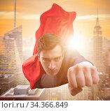 Купить «Flying super hero over the city», фото № 34366849, снято 5 августа 2020 г. (c) Elnur / Фотобанк Лори