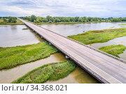 Aerial view of a bridge over shallow and braided Platte River near... Стоковое фото, фотограф Zoonar.com/Marek Uliasz / easy Fotostock / Фотобанк Лори