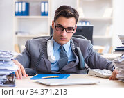 Desperate sad employee tired at his desk in call center. Стоковое фото, фотограф Elnur / Фотобанк Лори