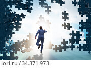 Купить «Businessman breaking the wall of jigsaw puzzle», фото № 34371973, снято 5 августа 2020 г. (c) Elnur / Фотобанк Лори