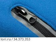 Black zipper with reflectors of blue fleece jacket pocket. Стоковое фото, фотограф EugeneSergeev / Фотобанк Лори
