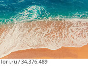 Sea sandy beach and wave of blue ocean. Natural holiday background. Стоковое фото, фотограф Zoonar.com/Galyna Andrushko / easy Fotostock / Фотобанк Лори