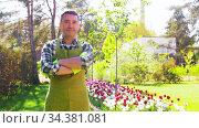 happy man in apron at summer garden. Стоковое видео, видеограф Syda Productions / Фотобанк Лори