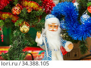 Russia, Samara, December 2019: Santa Claus doll a gift for children for the New Year is sold in the store . Редакционное фото, фотограф Акиньшин Владимир / Фотобанк Лори
