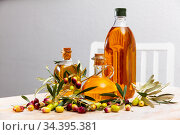 Different bottles with olive oil and olive branches. Стоковое фото, фотограф Яков Филимонов / Фотобанк Лори