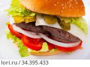 Double cheeseburger with beef, tomato, cheese, cucumber and lettuce. Стоковое фото, фотограф Яков Филимонов / Фотобанк Лори