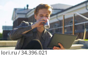 young man with tablet pc and drink on rooftop. Стоковое видео, видеограф Syda Productions / Фотобанк Лори