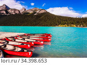 Beautiful red canoes for tourists are moored to the coast. Glacial... Стоковое фото, фотограф Zoonar.com/kavram / easy Fotostock / Фотобанк Лори