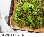 Kale Chips with salt on oven-tray, copy space. Стоковое фото, фотограф Ольга Сергеева / Фотобанк Лори
