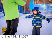 Cute little Caucasian ski adept exercising and listening to his ski... Стоковое фото, фотограф Zoonar.com/Pawel Opaska / easy Fotostock / Фотобанк Лори