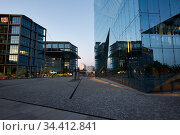 Berlin, Germany - Central station and the office building Cube Berlin in the evening. Редакционное фото, агентство Caro Photoagency / Фотобанк Лори