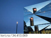 Berlin, Germany - The Buerogebaeude Cube Berlin with its folded glass facade. . Редакционное фото, агентство Caro Photoagency / Фотобанк Лори