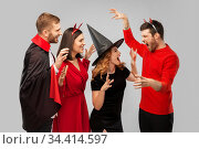 friends in halloween costumes scaring each other. Стоковое фото, фотограф Syda Productions / Фотобанк Лори