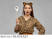 surprised woman in halloween costume of leopard. Стоковое фото, фотограф Syda Productions / Фотобанк Лори