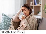 ill asian woman having headache at home. Стоковое фото, фотограф Syda Productions / Фотобанк Лори
