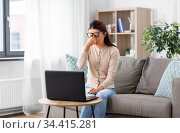 tired woman with laptop working at home office. Стоковое фото, фотограф Syda Productions / Фотобанк Лори