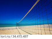 Volleyball net over sand beach and ocean view (2017 год). Стоковое фото, фотограф Сергей Новиков / Фотобанк Лори