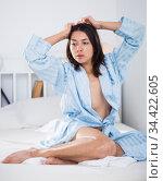 Seductive nude young sexy girl in bathrobe playfully posing in bed. Стоковое фото, фотограф Яков Филимонов / Фотобанк Лори