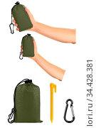 Very compact hand held green nylon pocket blanket in a drawstring... Стоковое фото, фотограф Zoonar.com/Arthur Mustafa / easy Fotostock / Фотобанк Лори