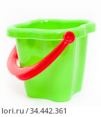 Green plastic children bucket with red handle on white background. Стоковое фото, фотограф Кекяляйнен Андрей / Фотобанк Лори