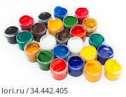 A lot of colorful paints in plastic boxes for drawing, a white background. Стоковое фото, фотограф Кекяляйнен Андрей / Фотобанк Лори