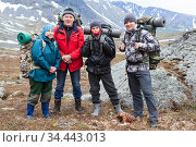 Group of hikers with backpacks, senior couple with young and adult men, happy mountaineers portrait. Стоковое фото, фотограф Кекяляйнен Андрей / Фотобанк Лори