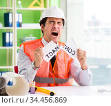 Angry construction supervisor cancelling contract. Стоковое фото, фотограф Elnur / Фотобанк Лори