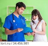 Female patient visiting male doctor in medical concept. Стоковое фото, фотограф Elnur / Фотобанк Лори