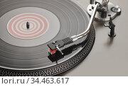 Turntable is playing vinyl LP record. Стоковое фото, фотограф Александр Лычагин / Фотобанк Лори
