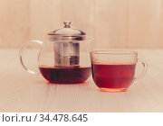 Tea pot with and cup faded. Стоковое фото, фотограф Zoonar.com/Ruslan Gilmanshin / age Fotostock / Фотобанк Лори