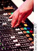 A man adjusts audio settings during a radio broadcast. Стоковое фото, фотограф Zoonar.com/Chris Putnam / easy Fotostock / Фотобанк Лори
