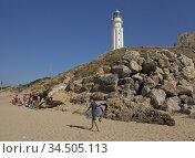 Surfers in Cape Trafalgar, Costa de la Luz, Andalucia, Spain. (2013 год). Редакционное фото, фотограф Julio Etchart / age Fotostock / Фотобанк Лори