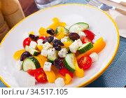 Plate of tasty Greek salad. Стоковое фото, фотограф Яков Филимонов / Фотобанк Лори