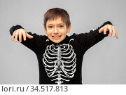 boy in halloween costume of skeleton frightening. Стоковое фото, фотограф Syda Productions / Фотобанк Лори