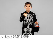 boy in halloween costume with candies and torch. Стоковое фото, фотограф Syda Productions / Фотобанк Лори