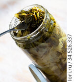 Pickled swiss chard with spices in glass jar on a wooden table. Стоковое фото, фотограф Яков Филимонов / Фотобанк Лори