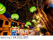 HOI AN, VIETNAM - SEPTEMBER 22, 2018: Traditional buildings at night... Стоковое фото, фотограф Zoonar.com/Chris Putnam / easy Fotostock / Фотобанк Лори