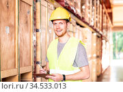 Portrait white caucasian warehouse worker stand with digital tablet... Стоковое фото, фотограф Zoonar.com/Vichie81 / easy Fotostock / Фотобанк Лори