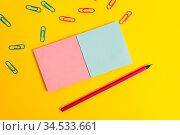 Colored square blank sticky notepads pencil clips plain color background... Стоковое фото, фотограф Zoonar.com/Artur Szczybylo / easy Fotostock / Фотобанк Лори
