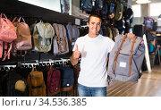 Ordinary man choosing new city backpack in shop. Стоковое фото, фотограф Яков Филимонов / Фотобанк Лори