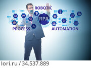 Businessman pressing buttons in RPA concept. Стоковое фото, фотограф Elnur / Фотобанк Лори