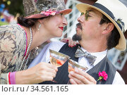 Attractive Mixed-Race Couple Dressed in 1920?s Era Fashion Sipping... Стоковое фото, фотограф Zoonar.com/Andy Dean Photography / age Fotostock / Фотобанк Лори